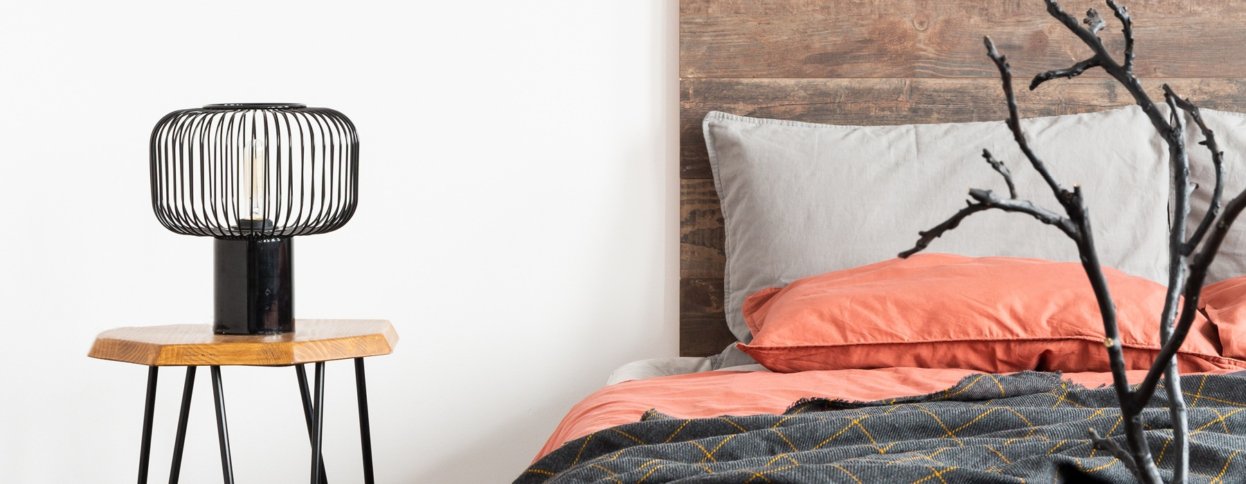 Image of a bed and side table